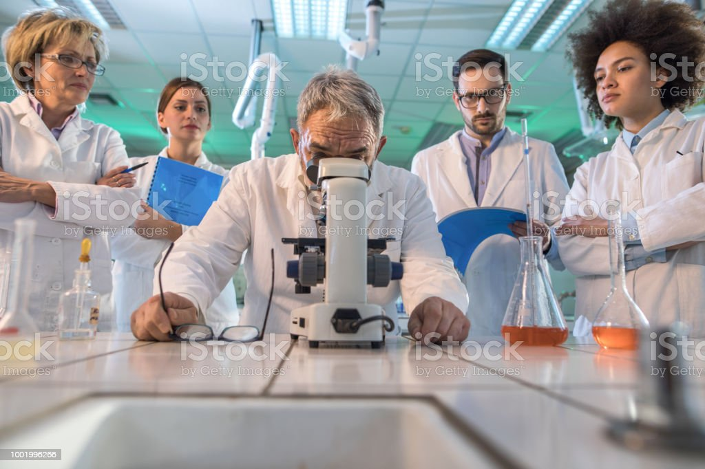 Low angle view of Low angle view of a senior scientist looking...