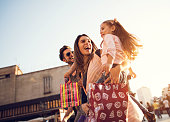 istock Below view of young cheerful family in shopping. 489803256