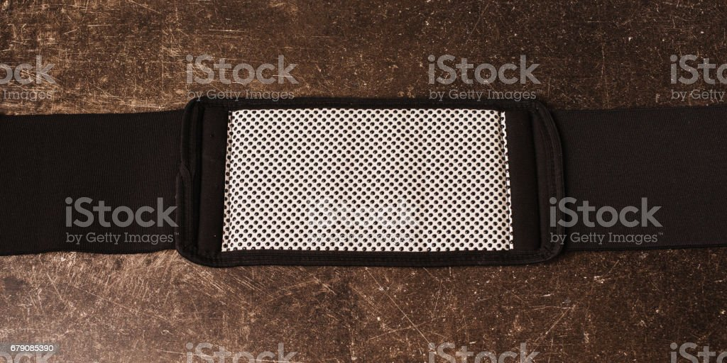 Belt for weight loss on a dark marble background. Relieve weight stock photo