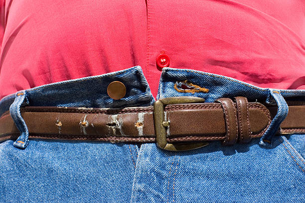 Belt Last Hole Tummy Last Hope after Lunch men in tight jeans stock pictures, royalty-free photos & images