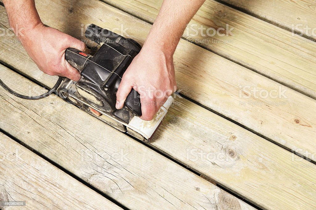 Belt Sander Sanding Deck Boards stock photo