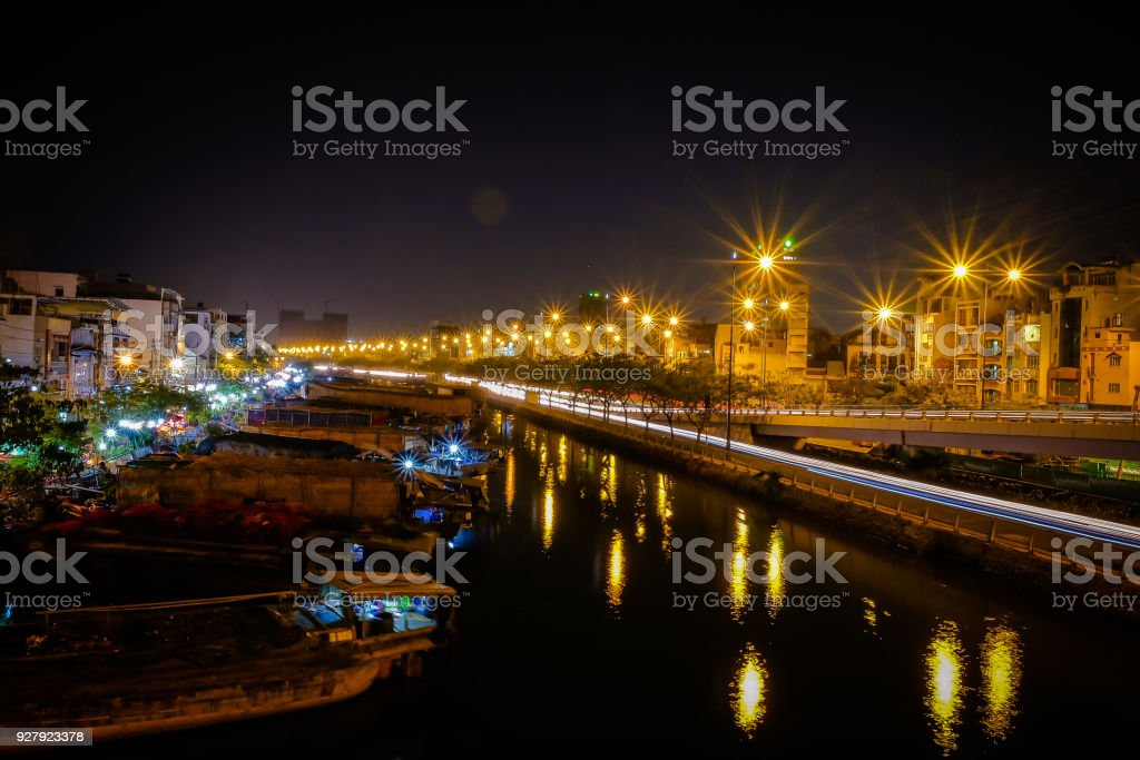 Ben Binh Dong (Binh Dong harbour) in lunar new year with flower boats along side the river, Sai Gon, Viet Nam stock photo