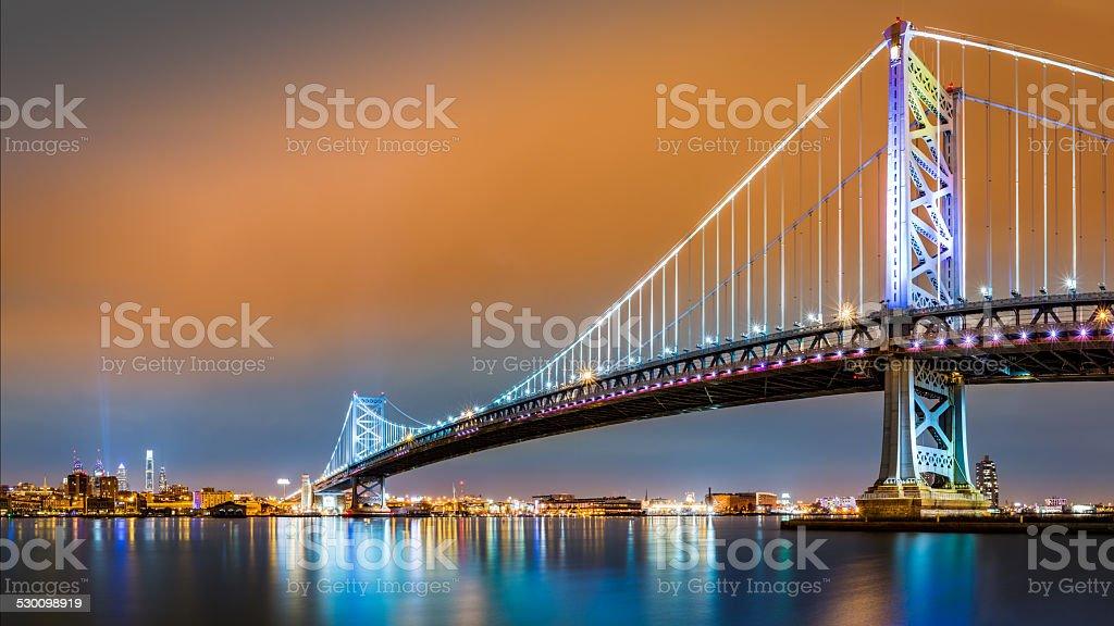 Ben Franklin Bridge and Philadelphia skyline by night stock photo