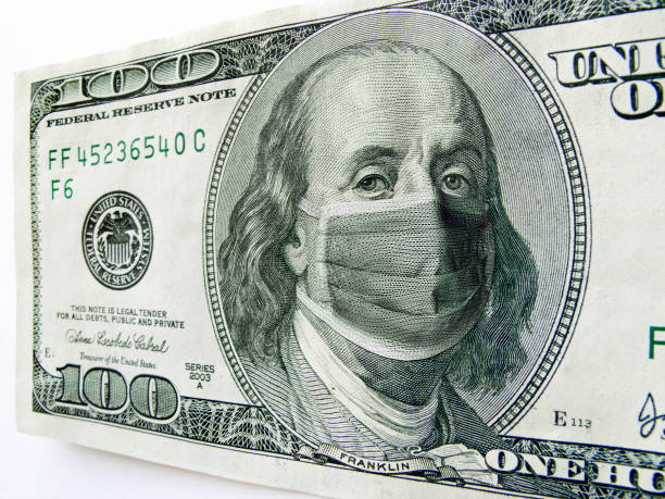 ben franklin wearing a coronavirus healthcare mask on one hundred dollar bill. - unemployment stock pictures, royalty-free photos & images
