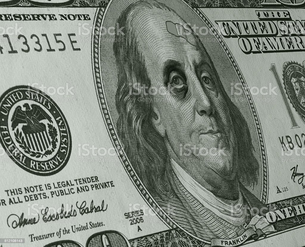 Ben Franklin with Black Eye and Band Aid on C-Note stock photo