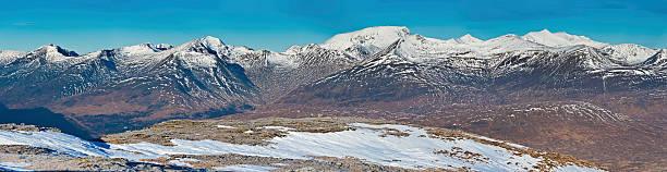 Ben Nevis winter snow summits wild Highlands mountain panorama Scotland stock photo