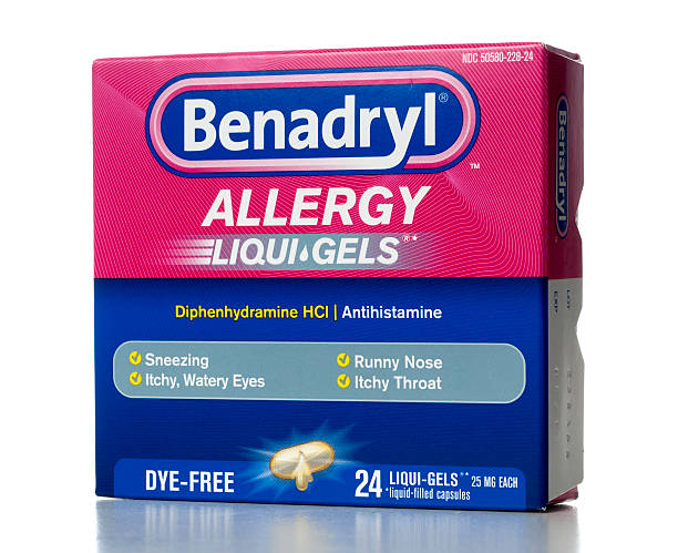 """Benadryl Allergy Liqui-Gels """"Miami, USA - March 13, 2012: Benadryl Allergy 24 Liqui-Gels capsules. Benadryl brand is marketed by Johnson & Johnson subsidiary McNeil Consumer Healthcare."""" antihistamine stock pictures, royalty-free photos & images"""