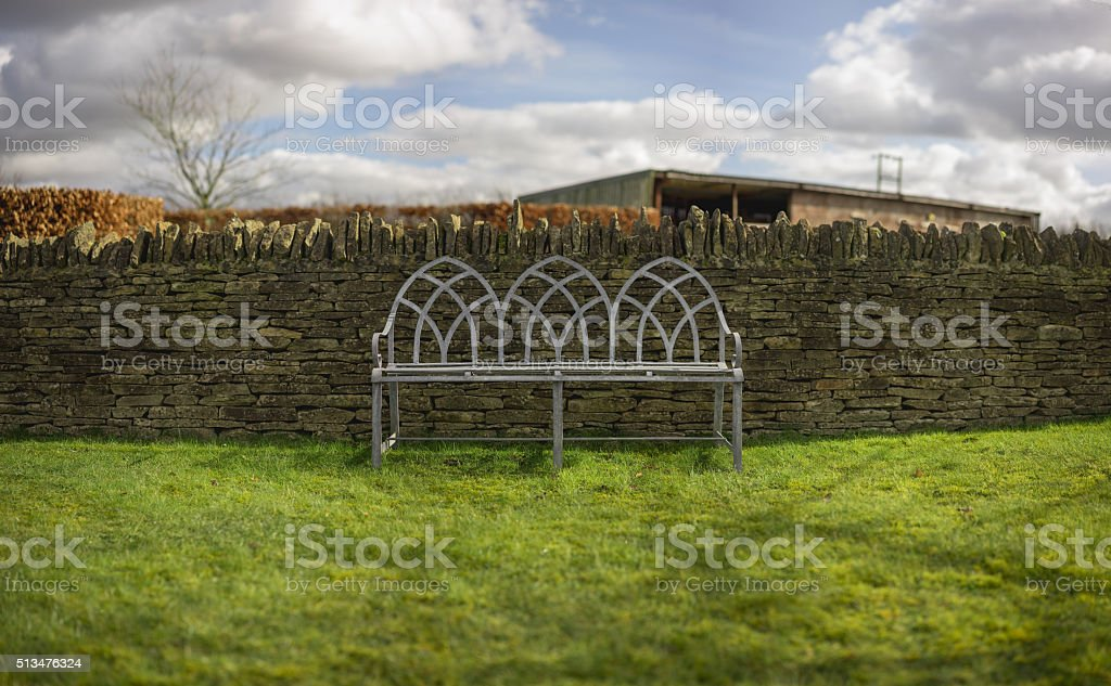 Bench and Dry-Stone Wall stock photo