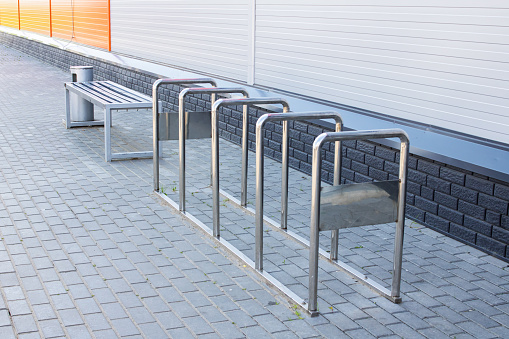 Bench and parking space for bicycles close up