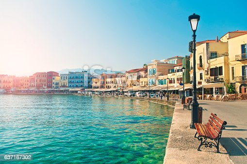 view of waterfront promenade with bars, hotels and restaurants in central historic part of Chania on sunny summer day, Crete, Greece