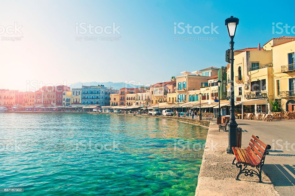 bench and street light by sea in European city stock photo