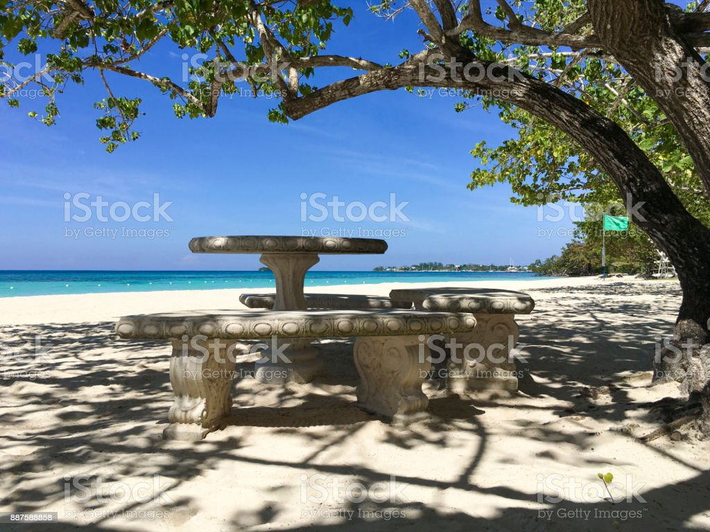 Bench and Table on the Beach of Negril stock photo