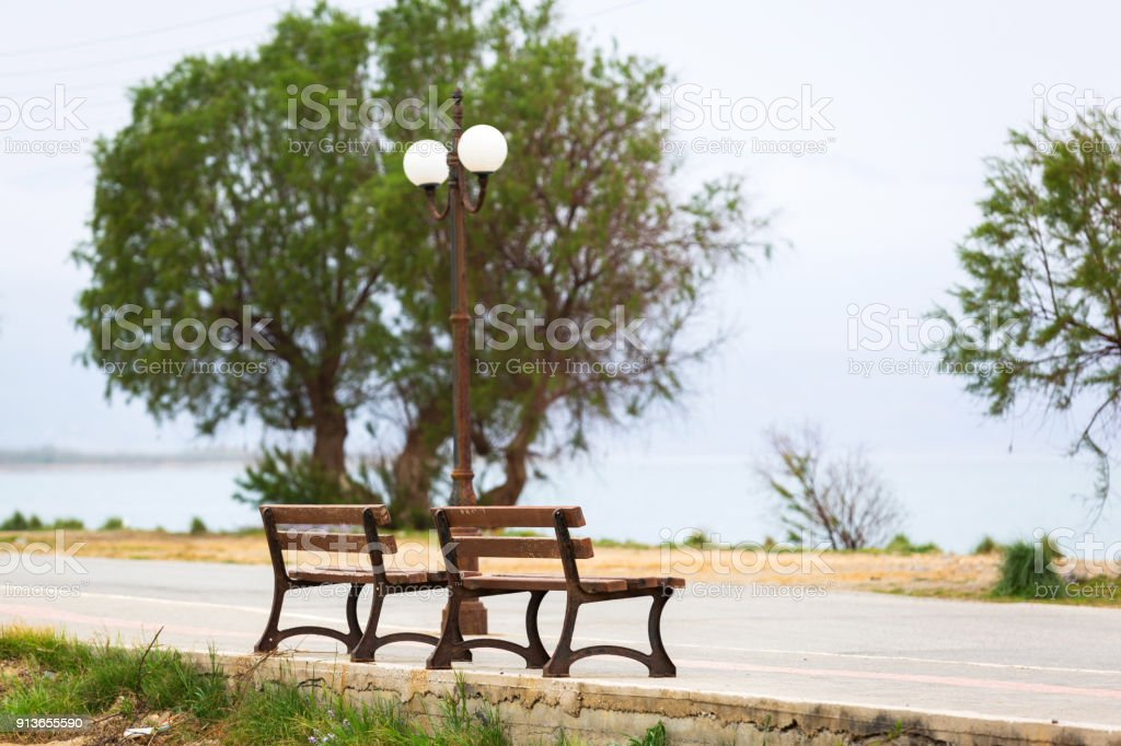 Bench at Maleme bech on Crete stock photo