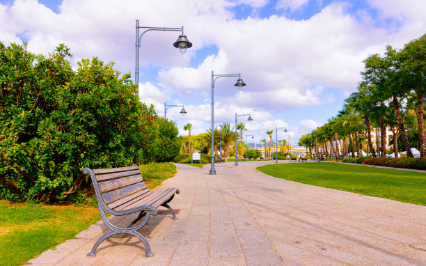 Bench at Parco Giardinetti Park in Old city of Olbia reflex stock photo