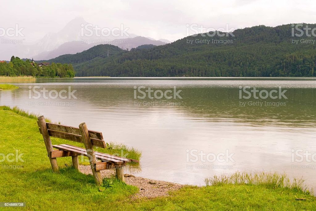 Bench by the lake  in the south of Bavaria, stock photo