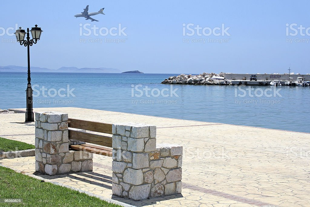 Bench by the Sea and Airplane stock photo