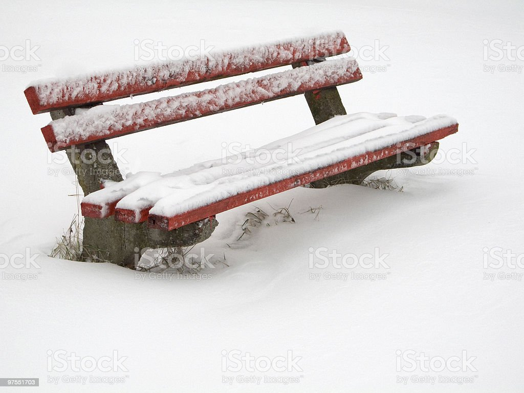 Bench covered in snow royalty-free stock photo