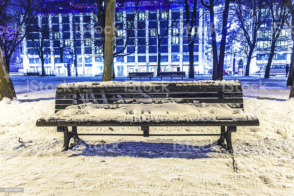 Bench covered with snow stock photo
