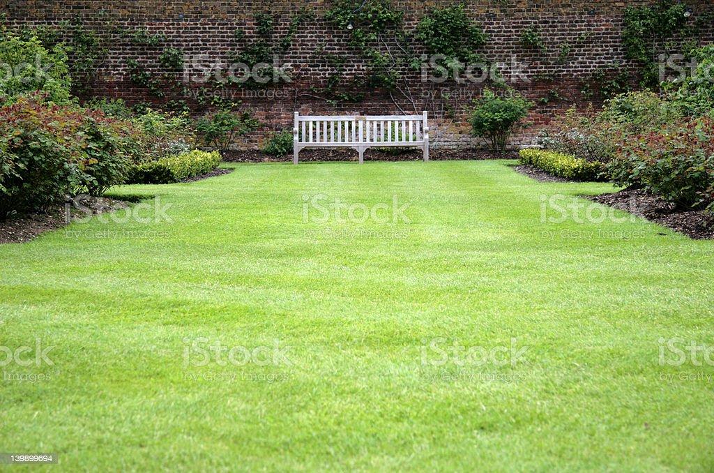 Bench in a garden royalty-free stock photo