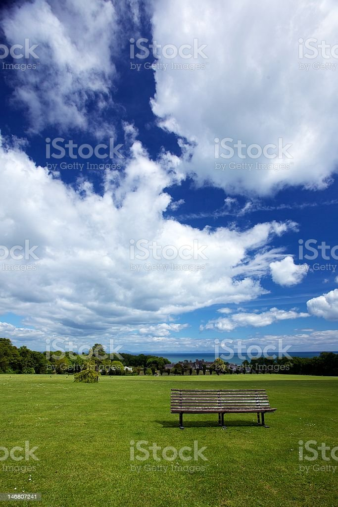 A bench in castle gardens royalty-free stock photo