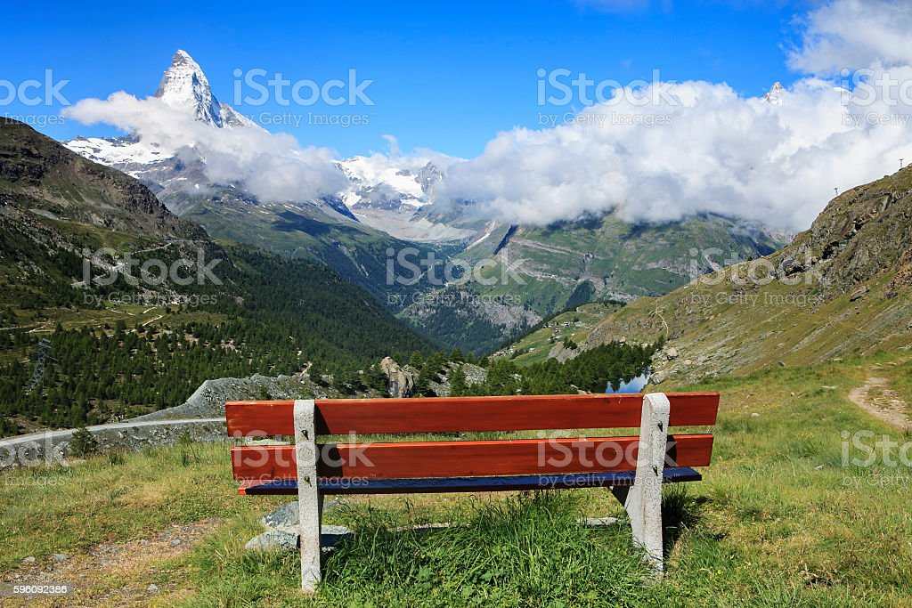 bench in front of the mountain royalty-free stock photo