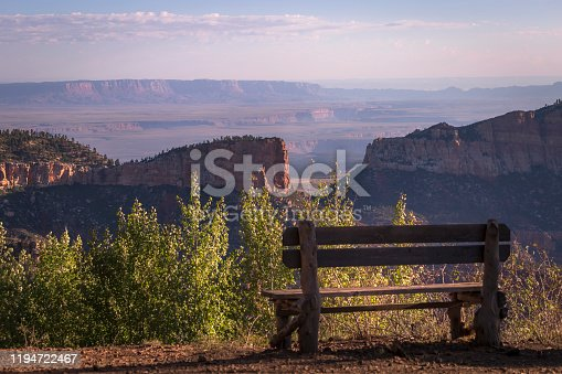 Bench in Grand Canyon North rim, dramatic landscape at dawn / sunrise – Arizona, USA