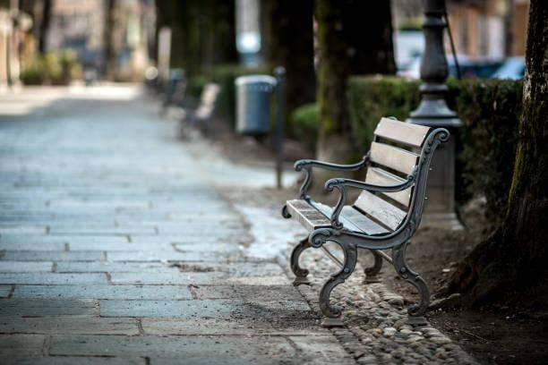 Bench in Italian town stock photo