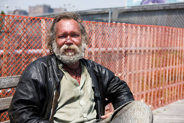 Bench in New York City, Portrait of Homeless Man, Copyspace stock photo