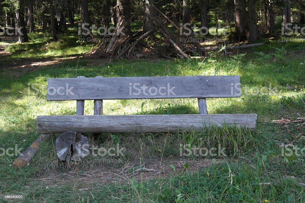 Bench in the european Alps stock photo