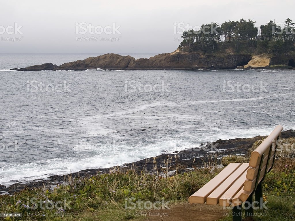 Bench looking into Pacific Ocean at Depoe Bay Oregon royalty-free stock photo