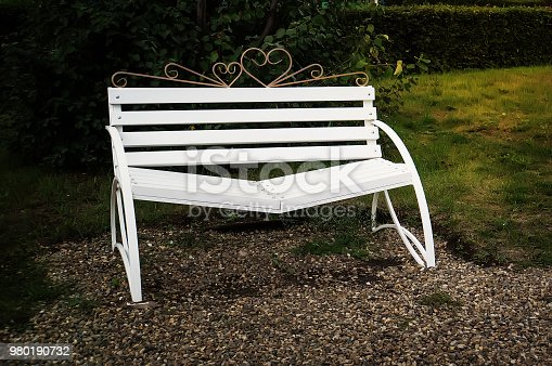 Bench of reconciliation. white bench in the Park in the evening