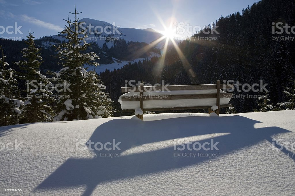 bench on a alpine winter medow in tirol austria royalty-free stock photo