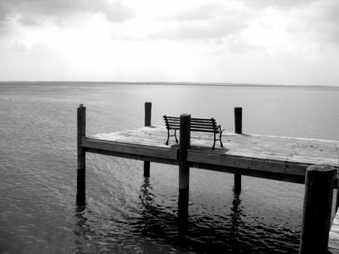 Bench on dock by the sea