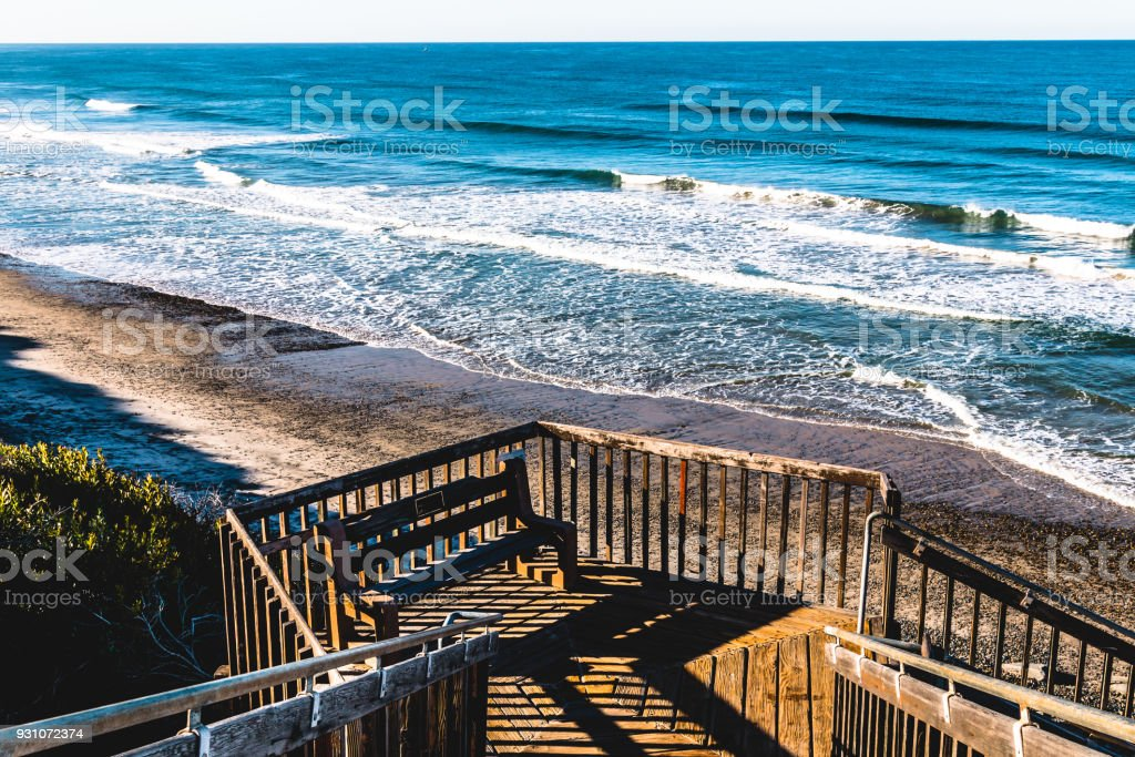 Bench on Landing of Staircase at South Carlsbad State Beach stock photo