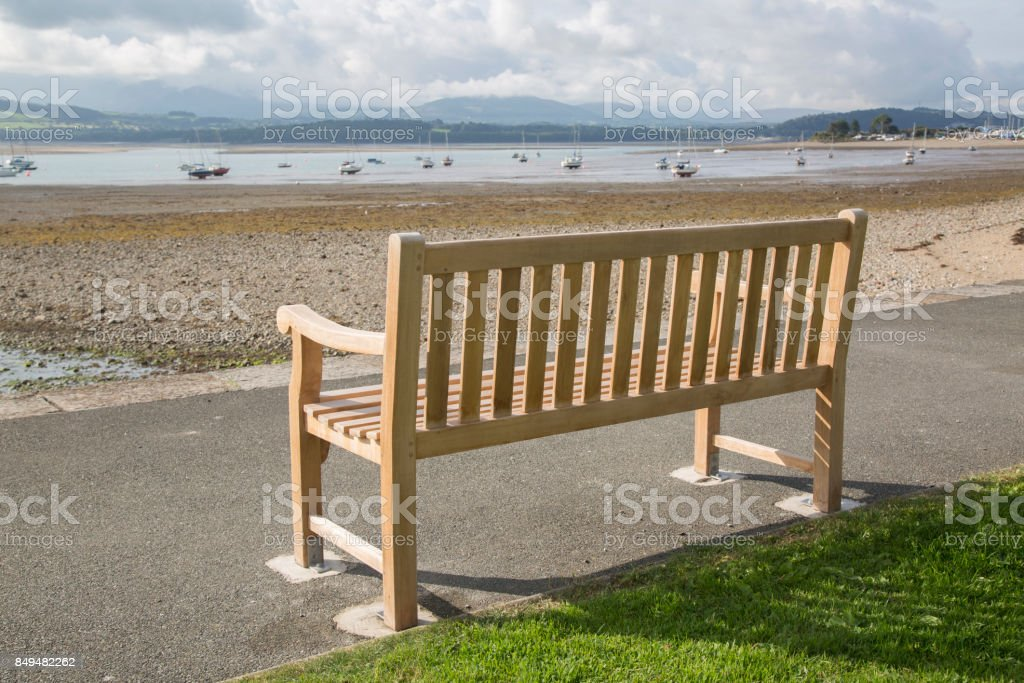 Bench on Seafront, Beaumaris, Anglesey, Wales stock photo