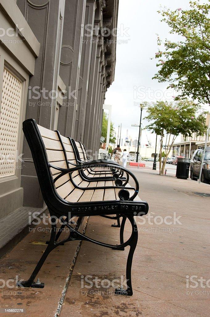 Bench on Sidewalk royalty-free stock photo