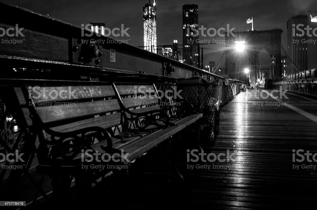 Bench on the Brooklyn Bridge at Night royalty-free stock photo