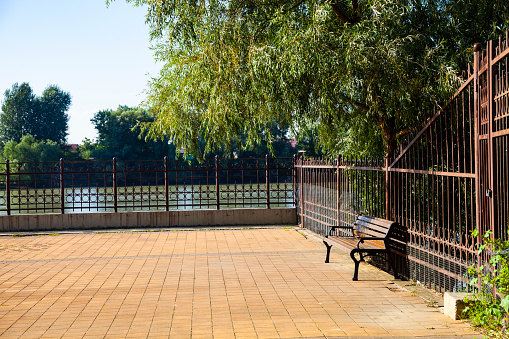 Bench on the embankment of the river