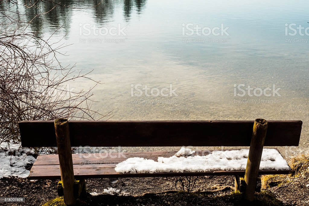 Bench on the shore stock photo