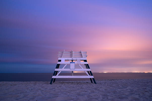 Bench on the tranquil beach stock photo