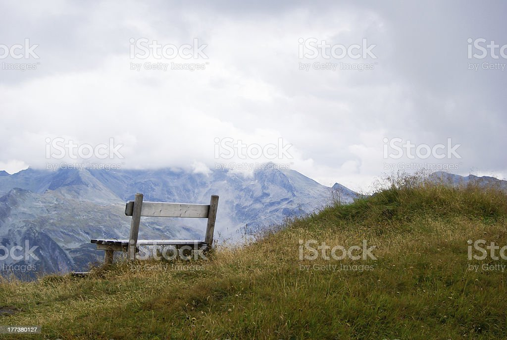 Bench on top of the mountain stock photo