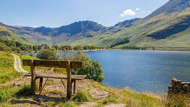 Bench overlooking Buttermere, Cumbria,The Lake District UK Small bench overlooking Buttermere lake in  Cumbria, The Lake District UK cumbria stock pictures, royalty-free photos & images