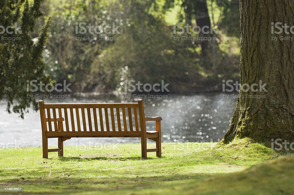 Bench overlooking river royalty-free stock photo
