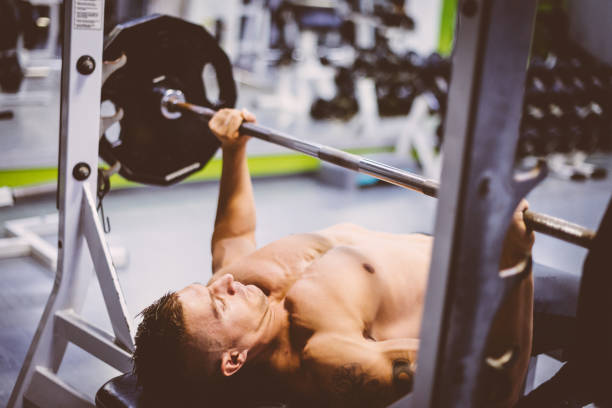Bench press exercise in gym stock photo