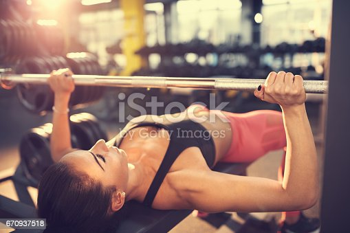 istock Bench press workout 670937518