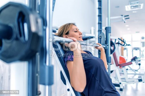 670937518istockphoto Bench press workout 960516776