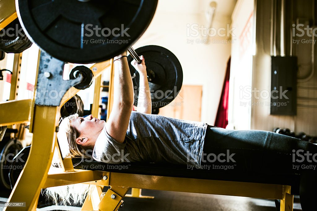 Bench Press Young Woman stock photo