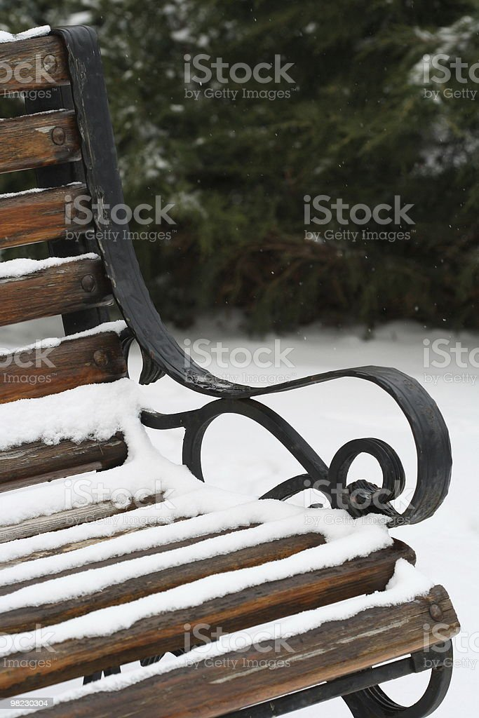Bench under the snow royalty-free stock photo