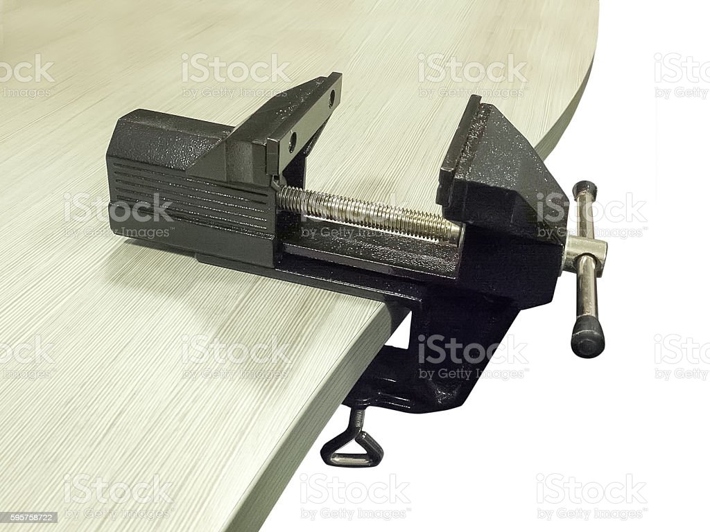 Bench vice on table stock photo