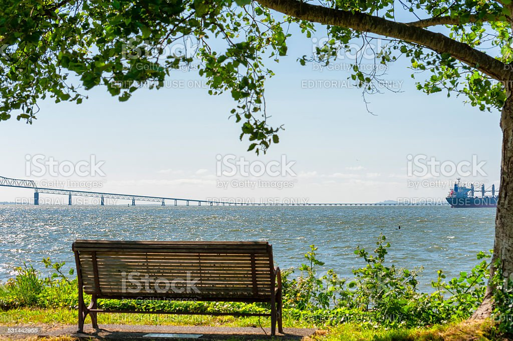 Bench view on the shores of the Columbia River stock photo
